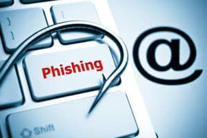 image of keyboard with a fishing hook to present phishing as a cyber attack